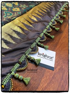 15 Best Kuchu Designs For Silk Saree - Tikli - India's Leading Fashion and Beauty Magazine Saree Kuchu New Designs, Saree Tassels Designs, Saree Blouse Patterns, Fancy Blouse Designs, Saree Blouse Designs, Choli Designs, Beaded Embroidery, Embroidery Designs, Passementerie