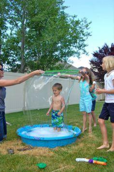 Giant Bubble Pool! A paddling pool, washing up liquid and a hula hoop!