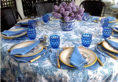 Blue and white tablescape with purple hyacinth centerpiece - Tory Burch