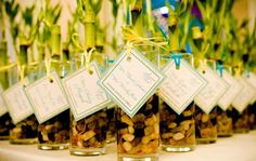 Bamboo plants as favors. I would have done this for my wedding if I didn't do a destination wedding. Love it!