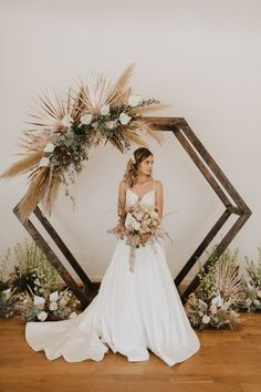 Hexagon arch with metallic palms, white palm fronds and pampas grass. So boho ch. Hexagon arch with metallic palms, white palm fronds and pampas grass. So boho chic for this winter bride at Rist Canyon . Palm Wedding, Boho Wedding, Floral Wedding, Wedding Colors, Wedding Bouquets, Wedding Flowers, Wedding Cakes, Purple Wedding, Wedding Ceremony Arch