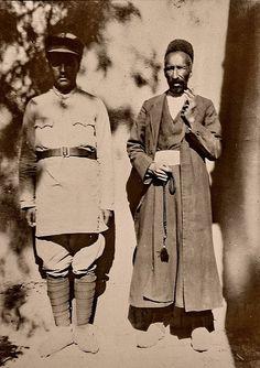 Persian cavalryman and Kurd, Iran, vicinity of Bushehr or Bushire.  From an 1920s photo album of a german merchant.