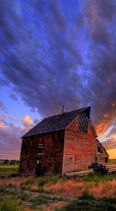 Old West Romance.  Beautiful sunset with rustic barn.