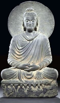 Image from http://artcentron.com/wp-content/uploads/2014/09/An-important-gray-schist-figure-of-Buddha-Gandhara-2nd-3rd-century.jpg.