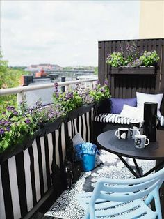 Black/white stripes and purple balcony with bench seating and a wood privacy panel
