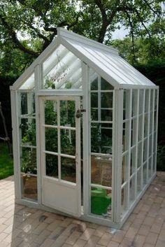 Google Image Result for http://minicontainergardens.com/wp-content/uploads/2011/05/Small-greenhouse.jpg