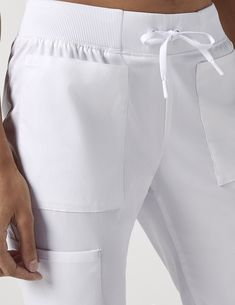 Drawstring 6 Pocket Pant in White is a contemporary addition to women's medical scrub outfits. Shop Jaanuu for scrubs, lab coats and other medical apparel. Dental Uniforms, Stylish Scrubs, Cute Scrubs, Scrubs Outfit, Medical Scrubs, Nursing Clothes, Professional Attire, Costume, Outfits