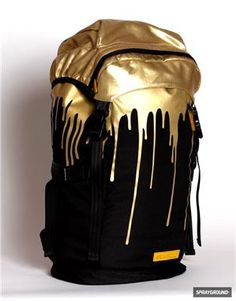 e4bebb19681d Sprayground - Gold Drips Top Loader Backpack. Gold Outfits For MenBlack ...
