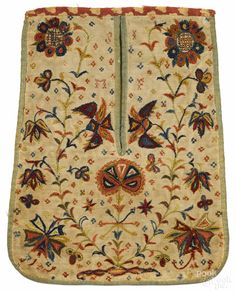 "Pennsylvania crewelwork pocket, mid 18th c., initialed SI and MF, with elaborate flowering vine decoration, 10 1/2"" x 8 1/2"". Provenance: Sotheby's Parke-Bernet, October 25, 1986, lot 147."