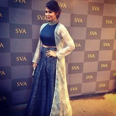 ...Blue crop top and skirt with a pretty lace styled long cape