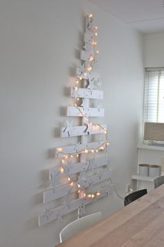 kerstboom...maybe something similar out of old wood for garden Xmas decor?