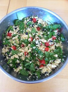 need to make this again-   Some couscous, cooked and fluffed with a fork  A bag of spinach  A box of cherry tomatos  A can of sliced black olives  A bag of pine nuts  A container of crumbled feta cheese    The dressing uses equal parts:  lemon juice  olive oil  rice wine vinegar  agave (or sugar)