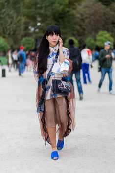 """30 Looks That Show The Many Sides Of """"French Girl"""" Style #refinery29  http://www.refinery29.com/2016/10/125501/pfw-spring-2017-best-street-style-outfits#slide-22  All those sheer pieces you don't know how to wear? Here's proof you can make them work...."""