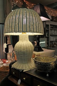 Vintage Wicker Lamp  Bought a couple and spray painted the bottoms a teal, gorgeous.