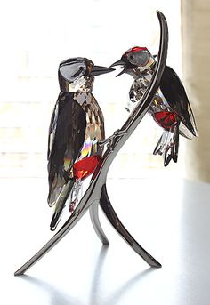 "Swarovski Woodpeckers, Black Diamond   $1,200.00 	8 5/8"" 		  Item# 957562 	  	  	     With the Woodpeckers, the designer Elisabeth Adamer has captured the typical pose of a mother feeding her young. In nature, the heads of the young woodpeckers will only turn black once they are fully grown - interpreted with an eye-catching detail in sparkling Light Siam crystal.  Mother woodpecker with young in Black Diamond and Light Peach crystal with accents in clear and Light Siam crystal…"