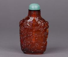 Chinese amber carved snuff bottle decorated with prunus and a bird, 1760-1820