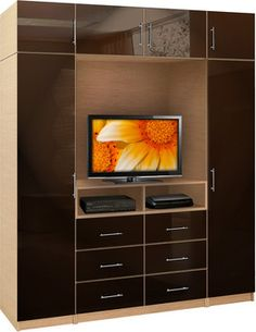 The TV wardrobe wall (extra tall version) offers a fantastic solution to a common problem. Where to put the TV, and a full wardrobe, and other items that need to be stored, where all will be easily accessible? Wonder no more, the Aventa colle