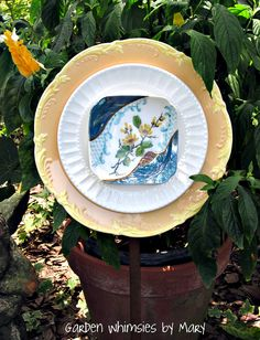 Plate flower with vintage dishes by Garden Whimsies by Mary