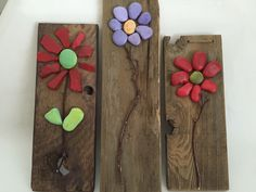 A personal favorite from my Etsy shop https://www.etsy.com/listing/233444132/rustic-rock-flower-on-reclaimed-wood