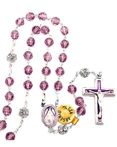 "Swarovski Crystal ""Miraculous Medal"" Sterling Rosary. High quality Swarovski crystal beads. Imported from Italy. 6mm Violet Crystal Swarovski Crystal Beads on Solid Sterling Silver Links. Features Swarovsky crystal ball Pater beads. Also features a beautifully enameled sterling silver Miraculous centerpiece. This stunning rosary's sterling silver enameled crucifix is 1 1/8"" in height. This rosary has an inner circular length of approx. 25"" and comes in a beautiful gift box."