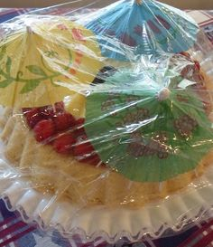 if you need to cover a dessert and don't want the plastic wrap to touch it, just stick a couple of these toothpick umbrellas into the cake!
