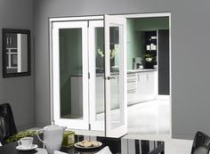 Finesse White 3 door internal bi-fold doors and room divider consists of a single glass pane of toughened safety glass with no bottom track for seamless flooring. Room Divider Doors, Sliding Room Dividers, Office Room Dividers, Sliding Doors, White Bifold Doors, Bi Fold Doors Internal, Internal Door Handles, Interior Barn Doors, Home Interior