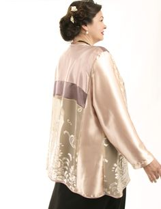 ON SPECIAL SALE NOW: This one-of-a-kind, Plus-Size special occasion Daisy jacket was created here in our Studio by collaging precious fabrics in champagne, ice, pink and silver.The Daisy Jacket is soft and comfy to wear as a cardigan, with contemporary elegance. #PeggyLutzPlus #plussizefashion #plussizemotherofthebride  #plussizespecialoccasion #plussizedesigner #plussizeclothing #plussizeholidayfashion #plussizefashionista #plussizedesignerjackets #plussizeartwear#plussizesale