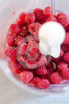 Fresh raspberries in a food processor by Zaharescu Mihaela Catalina, via Dreamstime