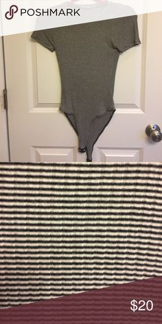 Stripped body suit No size on tag. Fits XS/S. worn once. Tops