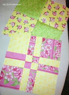 """From """"My Quilt Infatuation,"""" changing 4-patches into disappearing four-patches. I love how this picture shows both stages at once. It's difficult on pinterest to keep """"befores"""" and """"afters"""" together."""