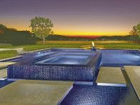 What could be a better setting for a resort-style spa and pool than this backyard, which offers a magnificent view of rolling hills and fields? Stunning by day or night, the blue tilework is accented by the water's reflective surfaces. www.amslandscapedesign.com