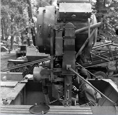 """Schützenpanzerwagen Sd.Kfz.251/20 (Infrarotscheinwerfer) Uhu. Introduced in late 1944, it mounted a 60 cm infrared searchlight with a range of 1.5 km for illuminating targets at night. Known as """"Uhu"""" (Eagle Owl), they guided IR sight-equipped Panther tanks to targets that were out of range of their own smaller infrared searchlights."""
