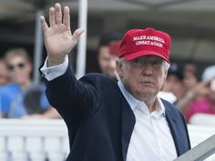 US President Donald Trump waves to well wishers as he arrives at the 72nd US Women's Open Golf Championship at Trump National Golf Course in Bedminster, New Jersey