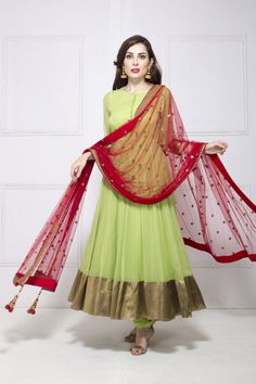 Pista green anarkali with contrasting red net dupatta