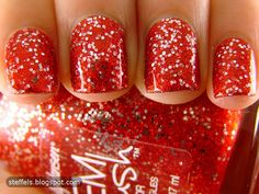 Red microglitter and small silver hexes..Sally Hansen