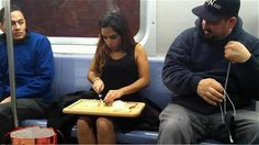 a woman cutting onions on a train in New York! WTF!