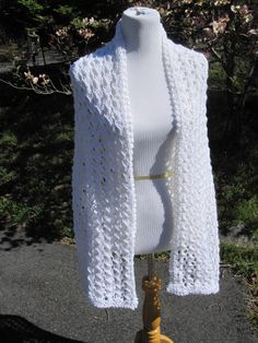 """Claire White Lace Knit Shawl  An elegant lacy white shawl knit with an acrylic yarn. Perfect for topping off a wedding dress to daily wear to on the town.Light enough for air conditioning in summer and but warm enougth for a cool day in spring. Knit with love.    Approx. 25"""" x 80"""""""