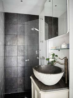 Nice bathroom design idea with clear glass shower door, black tile and extraordinary sink