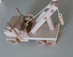USA Amish handcrafted wooden toy tow truck.