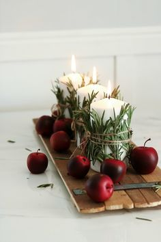 This candle centerpiece takes under 10 minutes to make and the possibilities are endless. Swap out the apples for pumpkins? Easy Christmas Decorations, Holiday Centerpieces, Christmas Table Settings, Candle Centerpieces, Christmas Candles, Holiday Tables, Holiday Decor, Minimal Christmas, Simple Christmas