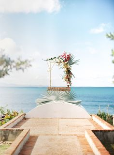 If you consider yourself a serious floral lover - and let's be honest, who doesn't? - this wedding is for you. Starting with a cascading bouquet followed by one incredible ceremony arch, and ending with tabletop florals fit for a tropical reception, this