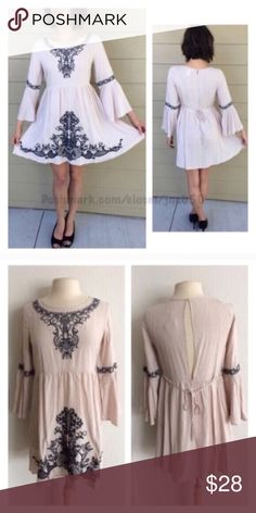 """Boho dress 100% rayon. Lightweight and extremely soft. This does not have any stretch to it, but it is slightly oversized. Semi open backside with ties. Measures 33"""" long with a 36"""" bust. Model is a S/4 and wearing a size S.                                          ⭐️This item is brand new without tags. 🚫NO TRADES 💲Fair offers will be accepted 💰Ask about bundle discounts Dresses Long Sleeve"""