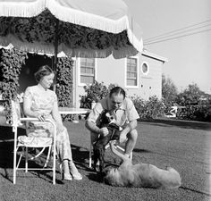 Gangster Mickey Cohen and his wife love on the exact thing at the lawn at their home Cheryl Crane, Italian Mobsters, Mickey Cohen, Frank Costello, Newspaper Front Pages, Honor Society, Gangsters, Life Pictures, Teenage Years