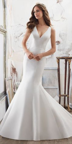 The Perfect Combination of Simple and Chic, This Larissa Satin Fit & Flare Wedding Dress Features Stunning Crystallized Back Detail. Covered Buttons Trim the Back and Train.