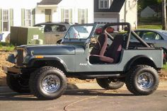 1976 grey Jeep CJ7 later made into short box pick-up