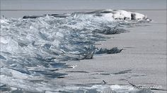 A frozen Lake Superior caused a major ice pile-up on the shores of Duluth, Minnesota on February 13th, its solid surface breaking into layers and layers of icy shards that ranged from 1/4″ to 3″ thick. The strangely satisfying scene was filmed by Dawn LaPointe of Radiant Spirit Gallery who captured the icy waves from several different angles from the lake's coast. Watching the misty phenomena almost makes you appreciate a long winter… almost.