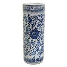 "Chinese porcelain umbrella stand with an intricate floral motif.       Product: Umbrella stand    Construction Material: Fine Chinese porcelain    Color: White and blue   Features:  Can be used for taller canes, umbrellas and long walking sticks    Beautiful decorative accent, a lovely decorative accessory near the door     Flower design   Dimensions: 23"" H x 8"" Diameter"