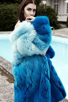 Quite a sight to see a blue dyed fur coat but totally digging it #RealistFashion