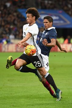 Leroy Sane of Germany holds off Raphael Varane of France during the International Friendly match between France and Germany at the Stade de France on...