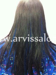 Blue peek-a-boo hair extensions cut and styled in medium hair!